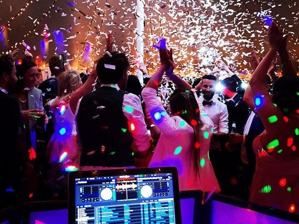 Hire a DJ is a fun way to entertain your guests at the wedding reception