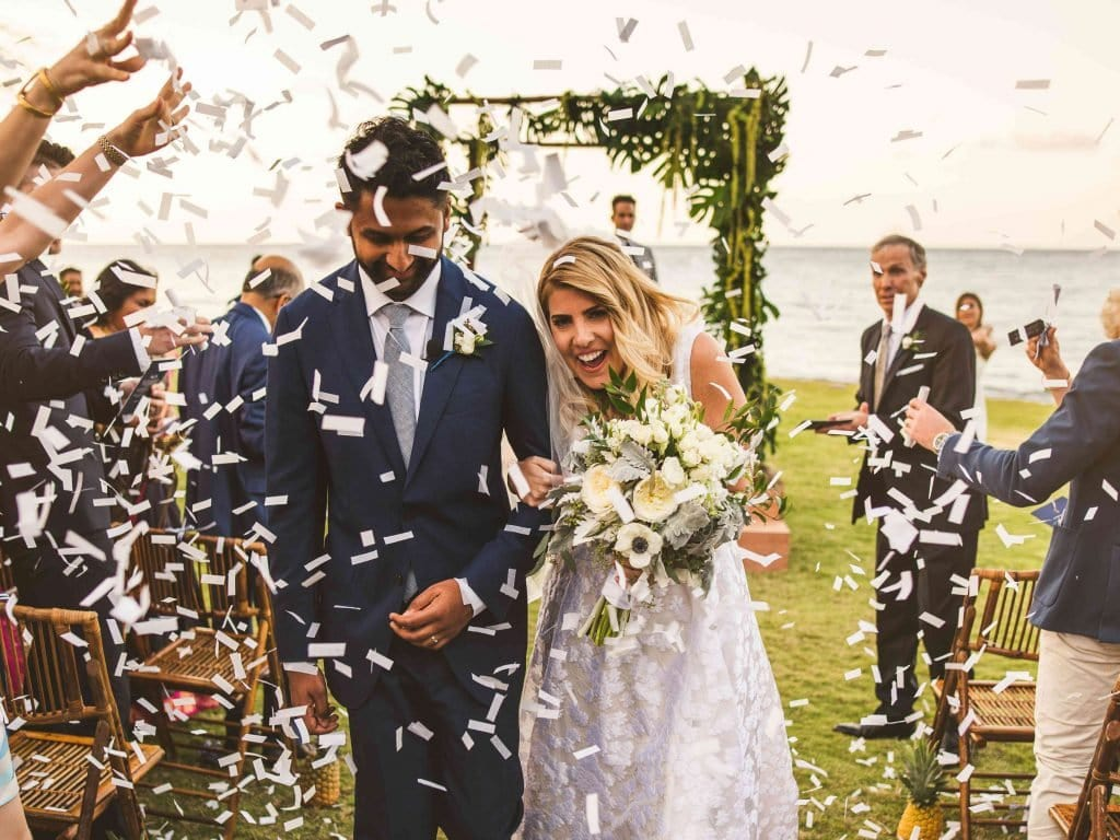 Walking between rows of confetti is another great idea for your wedding reception