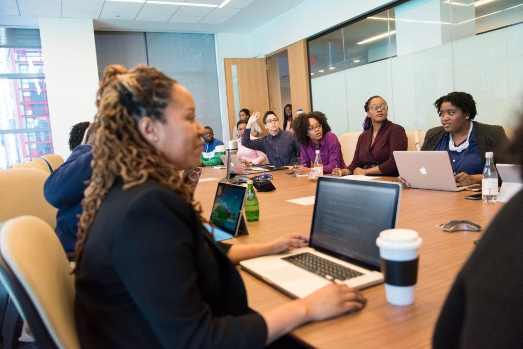 People mixing virtual facilitation with an in-person meeting.
