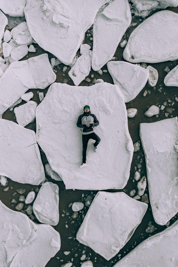 Man lying on broken ice
