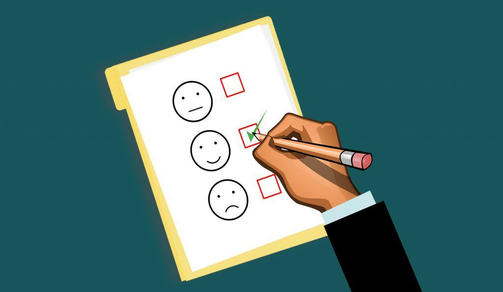 Illustration of man checking feedback box with faces.