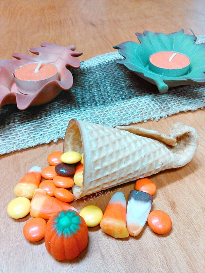 A cornucopia made out of an ice cream cone and orange candy.