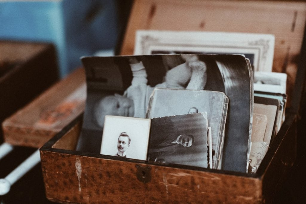 Old timey baby pictures in a chest.